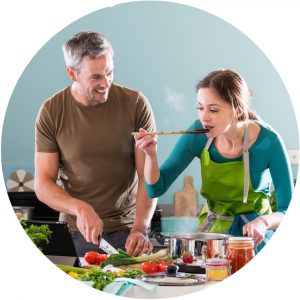 Couple cooking with bright vegetables